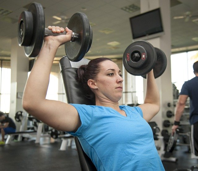 Female lifting weights.