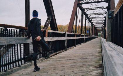 Athlete performing a hockey warm up on a bridge