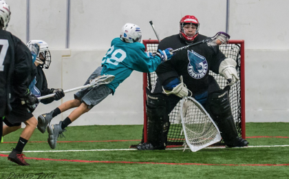 Youth playing lacrosse